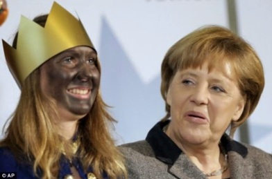 German Chancellor Angela Merkel posing Black faced magoi for traditional three Kings Day.  Yeah, black face is a thing in Germany