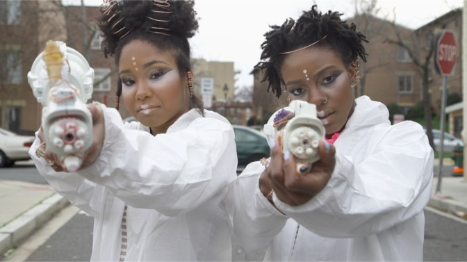 "The duo OSHUN, from the video for ""Protect Your Self"""